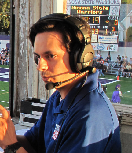Justin broadcasting Winona State Warriors football.